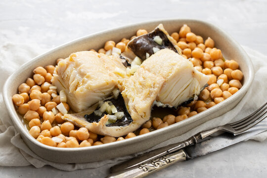 boiled cod fish with chick-pea on the dish