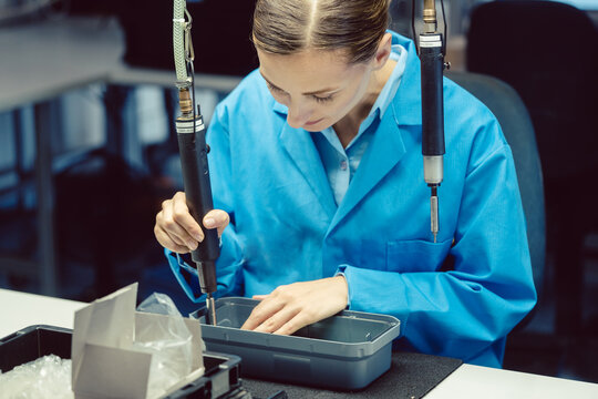 Woman in factory assembling a product