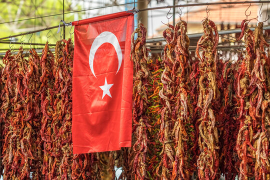 Turkish flag and dried chili pepper hanging on the market