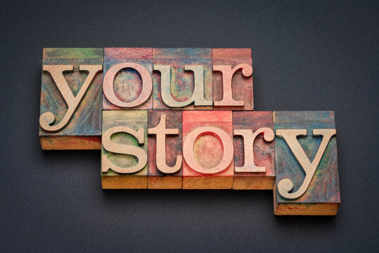your story - word abstract in vintage letterpress wood type stained by color inks, storytelling and life experience concept