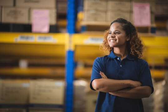 African American worker person working with safety in warehouse logistic factory, business manufacturing industry occupation concept, goods product box distribution