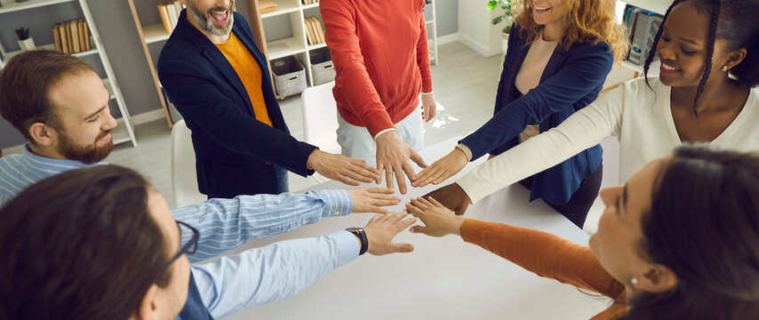 Banner with group of positive multiracial teammates, business partners, or friends joining hands. Teamwork, team unity, project kickoff, workshop with coach and mentor, participation, success concept