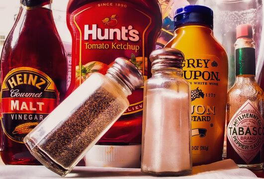 Salt, pepper and condiments mustard, catsup, hot sauce, malt vinegar