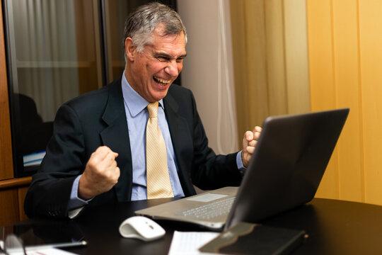 Happy businessman celebrating victory