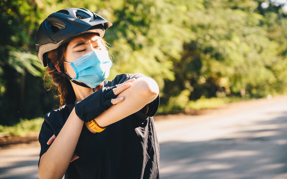 Cyclist woman feeling hot from UV rays while cycling in summer season. UV radiation can lead to serious health issues, including cancer.