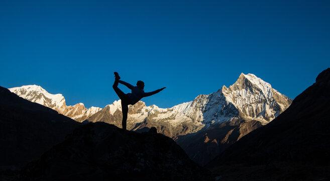 Yoga at sunset, Himilaya mountains, Nepal, Annapurna and Fishtail
