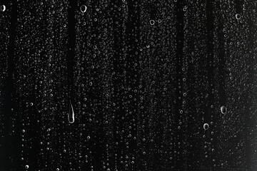 Obraz black wet background / raindrops for overlaying on window, concept of autumn weather, background of drops of water rain on glass transparent - fototapety do salonu