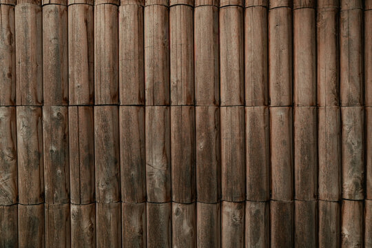 Round timber wall as background