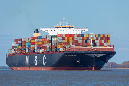 Stade, Germany – April 24, 2021: Container vessel MSC HAMBURG, owned by Mediterranean Shipping Company S.A., a Swiss-Italian international shipping line