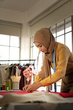 Muslim women run a small business in their own homes