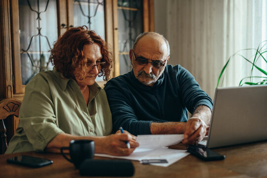 Senior couple doing some paperwork at home