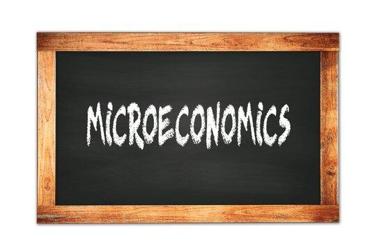 MICROECONOMICS text written on wooden frame school blackboard.