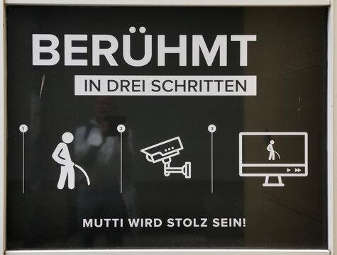 Schwarz-weißes Schild zur Abschreckung von Wildbieslern in der Innnenstadt von Erfurt