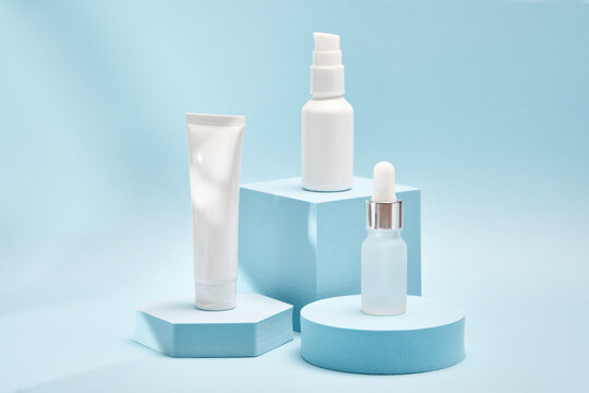 Three cosmetic product mockups on geometric podiums. Background for presentation of cosmetic