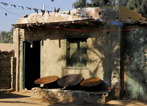 Tables are seen outside the house of a couple who try to improve their living conditions by selling food to tourists, in Saqqara village in Giza