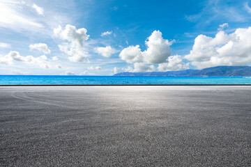 Asphalt road and sea landscape on a sunny day.