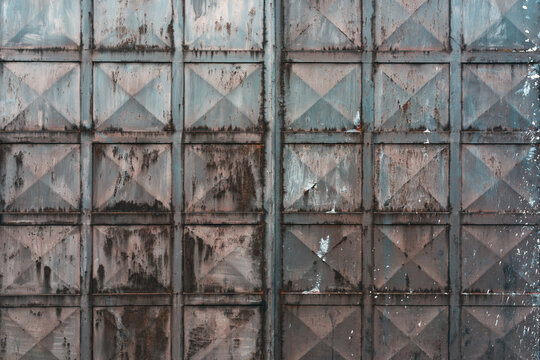 Texture of old worn metal gate as background