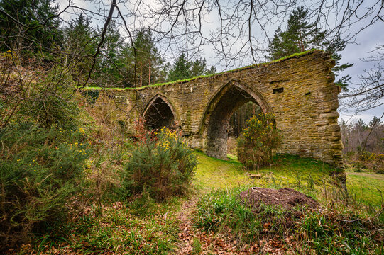 Gothic Arches of Dukesfield Mill, the remains of a lead smelting mill which was built in the 18th century, situated in woodland on the banks of Devils Water near Hexham in Northumberland