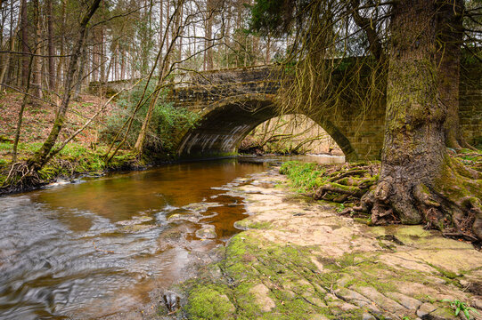 Dukesfield Mill Bridge above Devils Water, a river in Northumberland and is a tributary of the River Tyne, the confluence is between Hexham and Corbridge