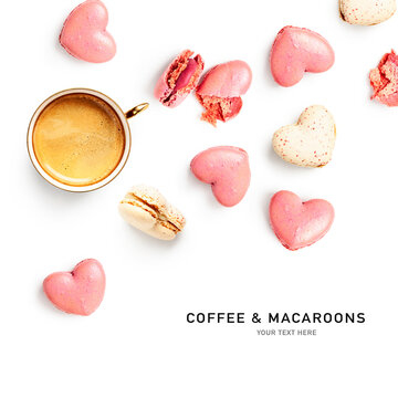 Coffee cup and macaroons creative layout.