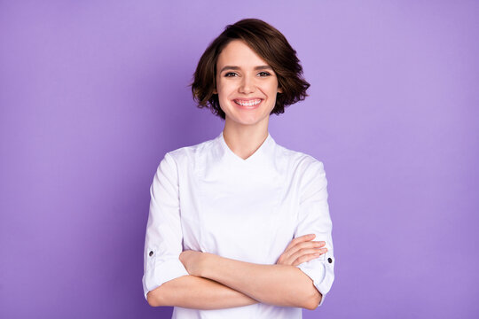 Photo of happy nice young woman folded arms good mood smile chef isolated on purple color background