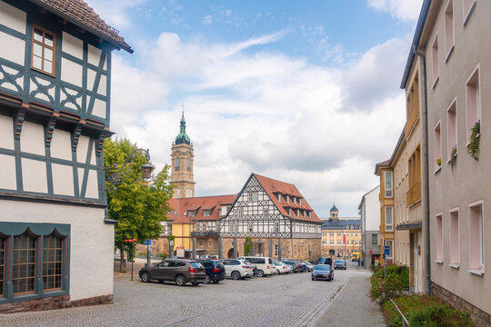 Museum of Luther with half timbered house by St George Church against cloudy sky in Eisenach, Germany