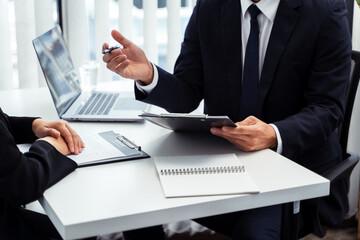 Fototapeta Examiner reading a resume during job interview at office obraz