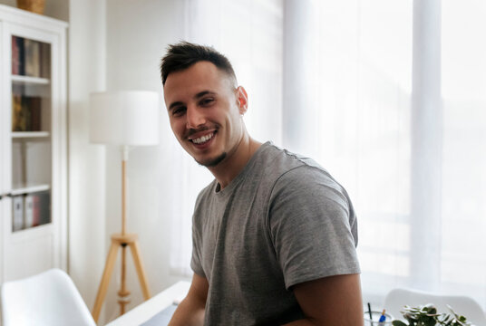 Smiling male entrepreneur at home office