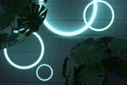 Silhouette plants against illuminated circle shape lights on brick wall