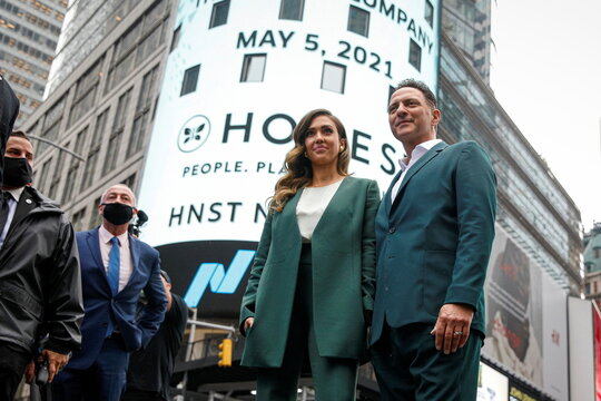 Jessica Alba, actor and businesswoman, poses with Nick Vlahos, CEO of The Honest Company, during the IPO in New York