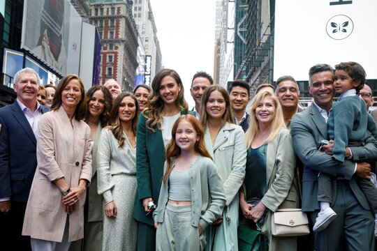 Jessica Alba, actor and businesswoman, poses for photographers with guests and family during the IPO of The Honest Company in New York