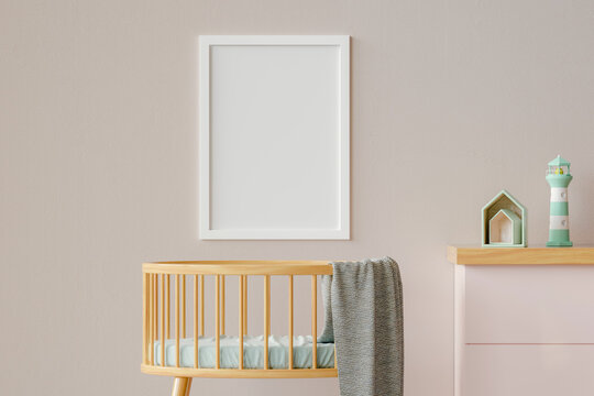 Three dimensional render of blank picture frame hanging on wall over empty crib