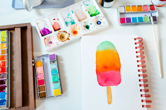 Colorful popsicle painted with watercolors on spiral notebook