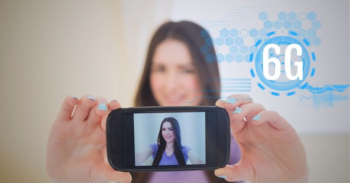 Composition of 6g text and data processing over woman holding smartphone with picture of herself