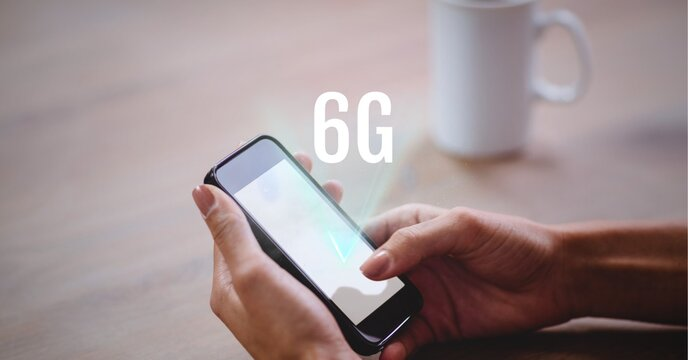 Composition of 6g text over woman holding smartphone in background