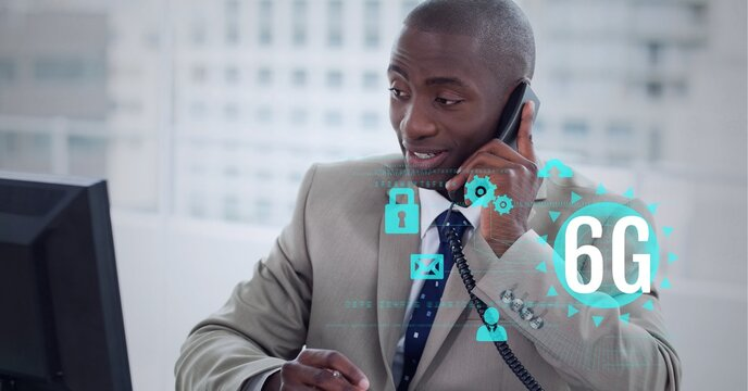 Composition of 6g text and icons over african american businessman talking on phone in office