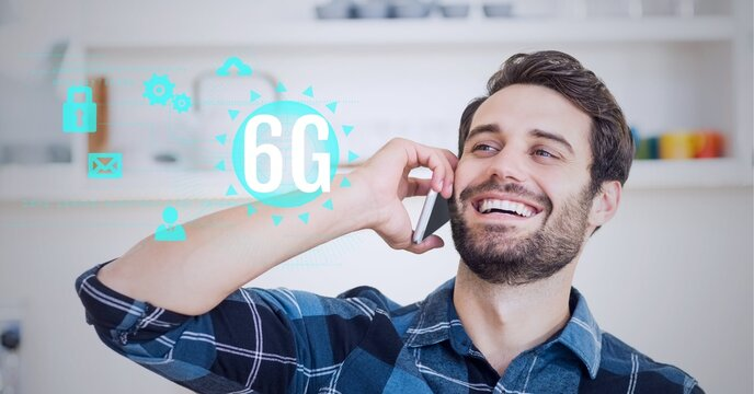 Composition of 6g text and icons over happy caucasian man talking on phone