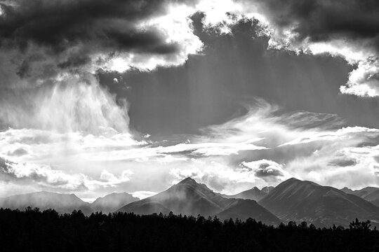 Late afternoon summer storms build and then move on over the Sangre de Cristo mountain range near Westcliffe, Colorado