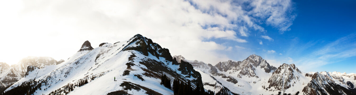 Sterling Roop stands on the ridge between Mount Ridgway and Mount Sneffels in the San Juan Mountains, Colorado.