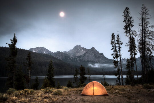 Camping under a moonlit sky on Stanley Lake, Idaho.