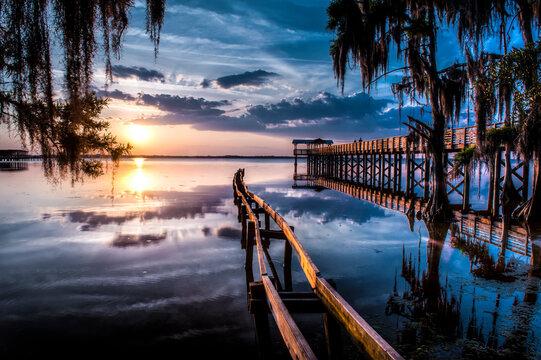 Jacksonville, FL: Sunset lights up the pier and canoe ramp