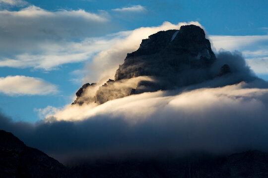 Fog swirls around the Grand Teton in Grand Teton National Park, Wyoming.