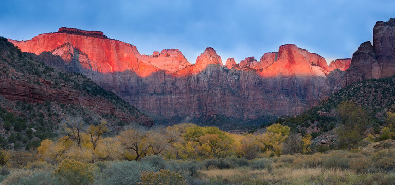 A stormy sunrise on the Towers of the Virgin in Utah's Zion National Park.