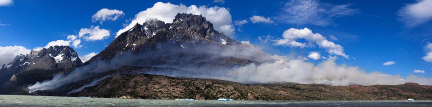 Triple image panoramic of the Torres del Paine National Park Wildfire in Patagonia, Chile.