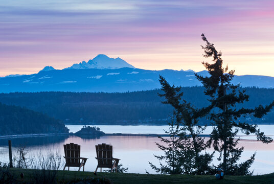The sun rises behind Mount Baker from the Bluffs Bed and Breakfast, Whidbey Island, WA