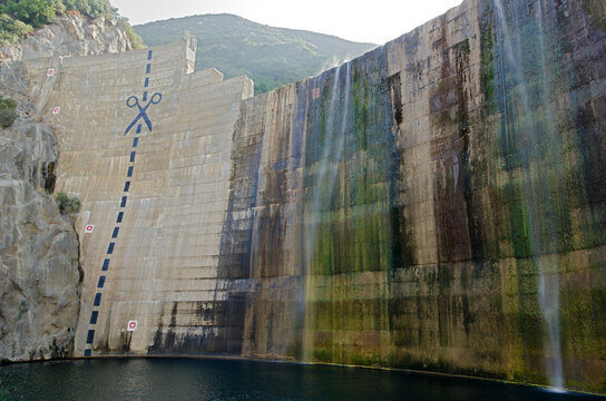 Scissors and cut marks painted on Matilija Dam from below in Los Padres National Forest near Ojai, California.