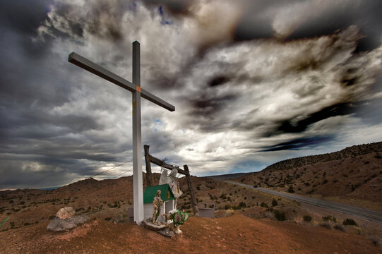 Cross on hill top in New Mexico