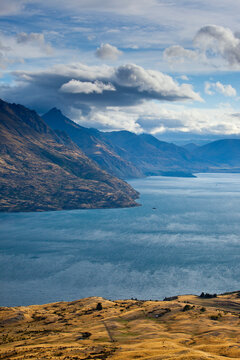 The Eyre mountains rise sharply above Lake Wakatipu after a rainstorm as seen from Kelvin Heights near Queenstown, New Zealand's South Island.