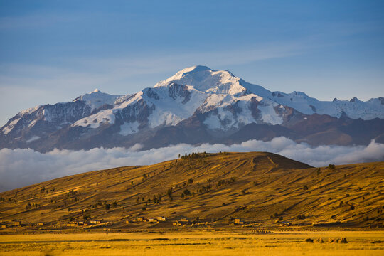 Mt. Ancohuma (6,427 m /086 ft) in the northern Cordillera Real as seen from the Bolivian Altiplano at sunset.