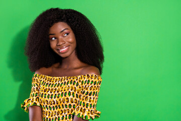 Photo of toothy sweet brown hair lady look empty space wear yellow top isolated on vivid green color background Wall mural